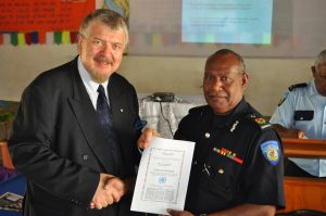 Mr Palu Lui, Commissioner of the Vanuatu Police Force is awarded Ciitizen for Humanity Certificate by Dr Sev Ozdowska, OAM, ACHRE President after participation with other Senior Police Officers in Human Rights training in Port Villa on 18 September 2009.