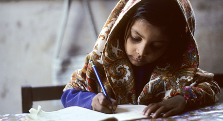 A young girl does her school work in Karachi, Pakistan.